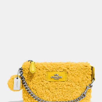 COACH NOLITA WRISTLET 15 IN SHEARLING | Dillards