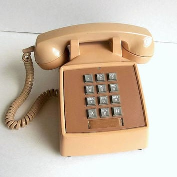 Vintage Stromberg Carlson Hip Retro 1970's touch tone desk top telephone, pinkish beige phone push button made in USA