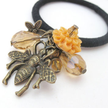 Ponytail holder with golden yellow flower and bronze bee