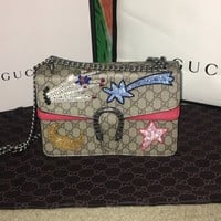 Gucci Dionysus Supreme Bag with red leather flap