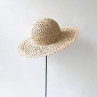 Vintage woven straw hat. natural floppy hat. wide brim sun hat.