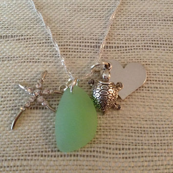 Sea glass green pendant with turtle and starfish charms and personalized heart.  Green sea glass and charm necklace.