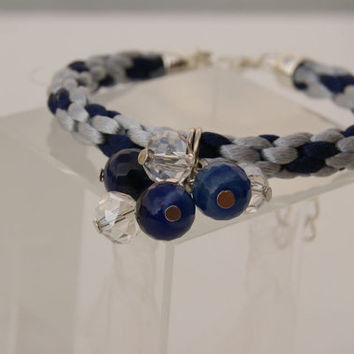 Light Silver Grey and Blue Kumihimo Braided Bracelet. Bangle in Satin Cord with Czech Glass and Crystal Beads as a Central Motif.