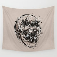 skull with demons struggling to escape Wall Tapestry by Pakowacz
