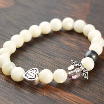 Mother of Pearl Bracelet. Women's Beaded Bracelet. Celtic Heart Bracelet. Angel Wing Bracelet. Women's Yoga Bracelet. Lotus & Lava Bracelet.