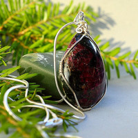 Eudiialyte pendant pear shape Argentium wire wrapped with a solid silver necklace