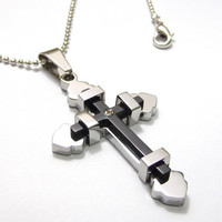 A stainless steel cross pendant necklace, A silver plated and black rhodium plated symbol stainles cross pendant