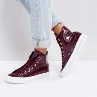 Converse Chuck Taylor High Trainers In Patent Burgandy at asos.com