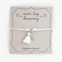Angel wings bracelet, wish bracelet with tassel charm, gift for her, white cord bracelet, never stop dreaming