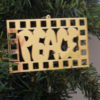 "One mirrored acrylic laser cut ornament ""Peace"" color choice, approx. size 4"" x 2-1/2"""