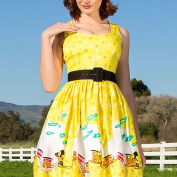Pinup Couture Aurora Dress in Mary Blair Yellow Train Border Print