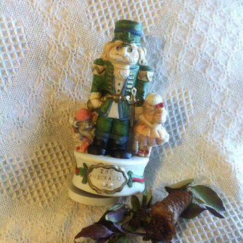 Nutcracker Musical Statue Vintage Nutcracker Ceramic Figurine With Music Box Girl and Mouse Plays Toyland Tune Hand Painted Bisque Soldier