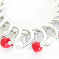 Medium knitting stitch markers | snag-free stitchmarkers | snagless stitch markers | silver rings; red, clear, and frosted beads | #0038