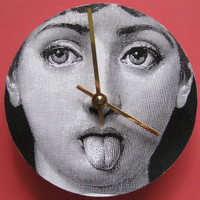 The lady has attitude.  Small Fornasetti image wall clock.