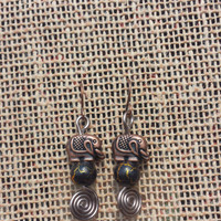 Brass Colored Elephant Swirl Earrings with Black/Gold Bead **25% of the proceeds will be donated to The Elephant Sanctuary**