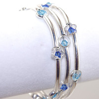 Silver plated tube bead memory wire bracelet Light blue sapphire navy Swarovski crystal Stack wrap Flower ring Coil layer bangle braclet