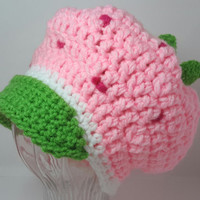 Crochet pink strawberry hat. With green stem and brim. Fits sizes 1 to 3 years old. Shortcake inspired.
