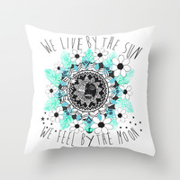 We live by the sun, We feel by the moon. Throw Pillow by Sara Eshak