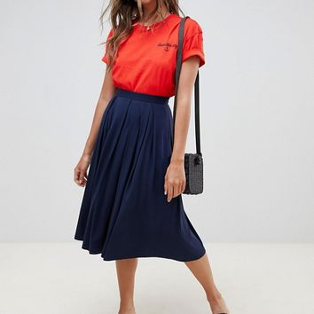 ASOS DESIGN midi skirt with box pleats at asos.com