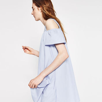 CUT-OUT DRESS WITH FRILLY SLEEVES.