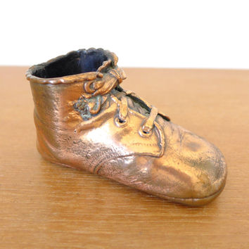 Single bronzed baby shoe