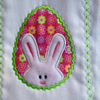 Burp cloth with a white bunny on a bright pink egg. Perfect for baby at Easter. It can be personlized for and extra charge.