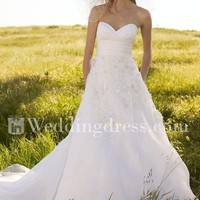 strapless bridal gown with beaded flowers, elegant wedding dress