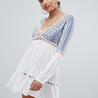Missguided Embroidered Cheesecloth Swing Dress at asos.com