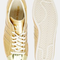 Adidas | adidas Originals Superstar 80's Gold Metallic Sneakers at ASOS