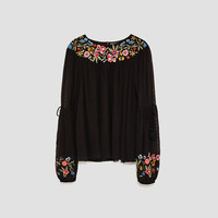 TOP WITH EMBROIDERED SLEEVES AND NECKLINE