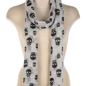 Capture a memorable moment with the Skull Print Gauze Scarf. Featuring a lightweight woven fabric and skulls print throughout.