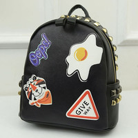 Black Poached Egg And Tiger Head Print Stud Detail Backpack