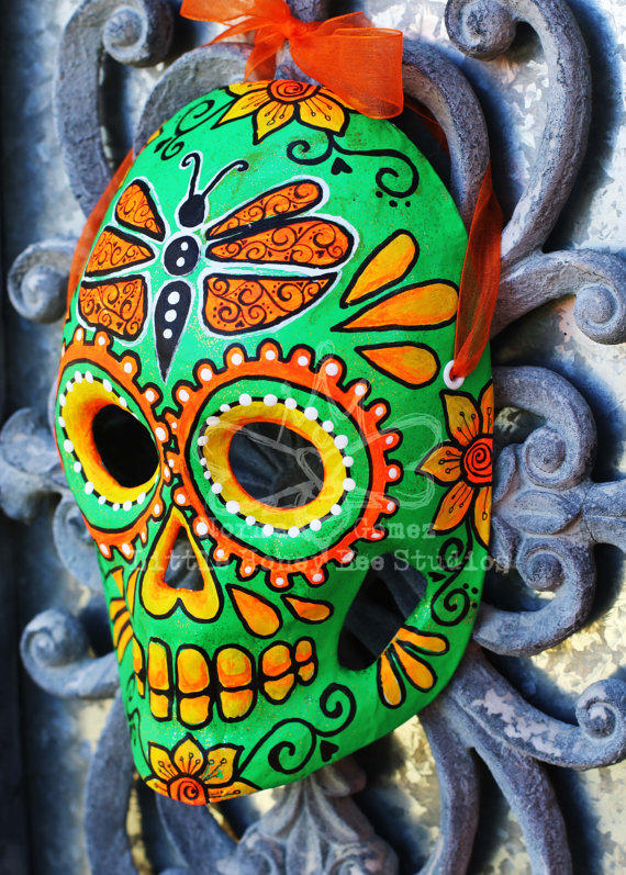 green and orange dia de los muertos mask from artist normagomez y