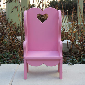 Pink vintage wood doll chair with heart cutouts