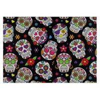 Colorful Sugar Skulls On Black Cutting Board
