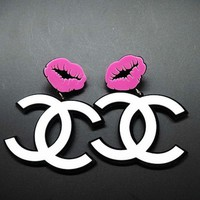 DCCKJ1A Chanel exaggerated atmosphere big mouth big earrings Purple