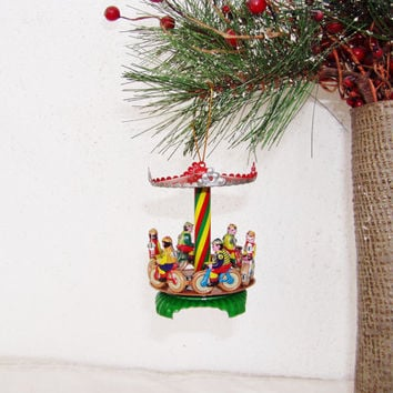 Vintage tree ornament, Christmas tree carousel ornament, vintage toy with bike riders, colourful moving merry go round, late eighties