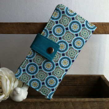 Aqua and blues circle design folded wallet with coin pouch, card slots, bill slots