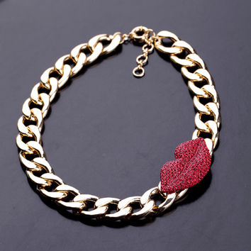 Gold tone Link Necklace with lip accent