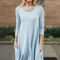 Solid blue rayon dress with criss cross split neck