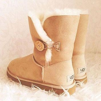 DCCK8X2 UGG' with the buttons on the boots and bowknot boots