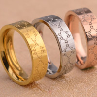 Red and green pattern letters titanium steel plated 18k rose gold ring couple ring men and women ring
