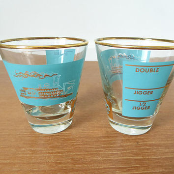 Two vintage Libbey Southern Comfort Riverboat jiggers in excellent condition