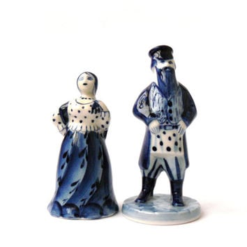 Two vintage porcelain figurines gentleman and lady, Figures man and woman, white and blue colours, painting Gzhel.