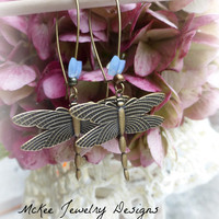 Brass aged Dragonfly Earrings with purple blue butterfly crystals.