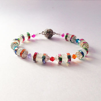 Caitlin bracelet .. Milk glass rondelle beads, colourful bicone beads, rainbow rhinestone spacers with rhinestone encrusted clasp.