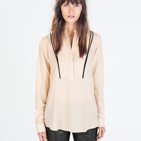 Jacquard blouse with piping