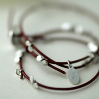 Silver petals on rouge leather bracelet