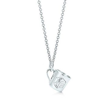 Tiffany & Co. -  ABC baby cup charm in sterling silver on a chain.