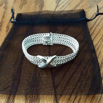 KISS Sterling Silver Bracelet mesh with a fancy X design. Secure locked clasp! Nice heavy bracelet! Gift for you or HER!